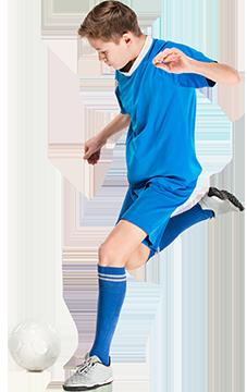 a kid kicking a soccer ball