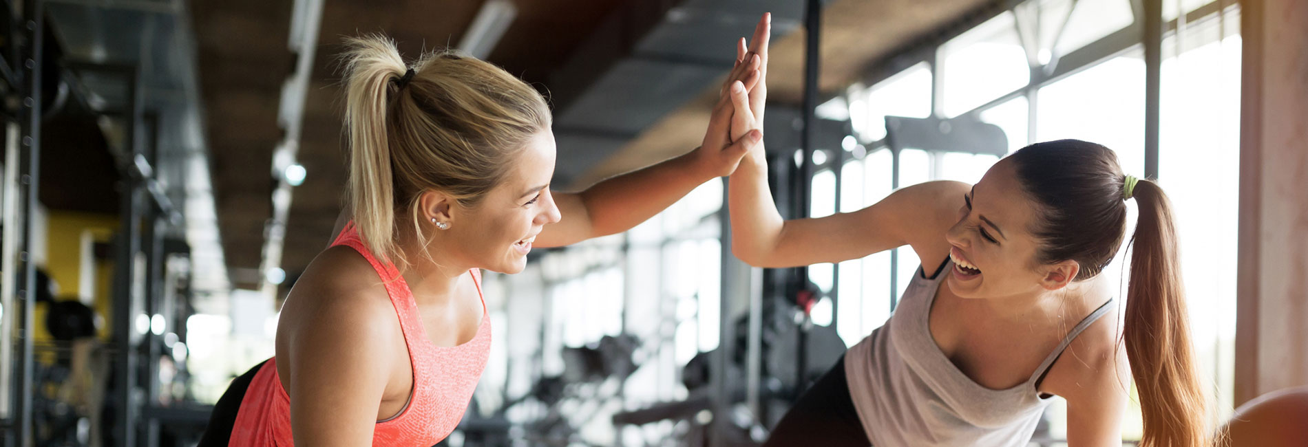 two girls working out high fiving